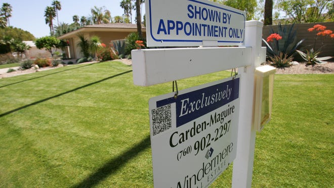 A for sale sign is posted in front of 1033 E. Sierra Way in Palm Springs, Calif. on Tuesday, March 27, 2012. The home is about 2,800 sq. feet. Crystal Chatham, The Desert Sun