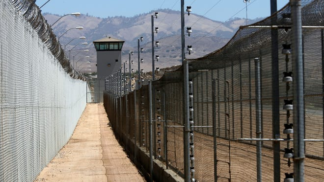 A triple fence system surrounds Salinas Valley State Prison.