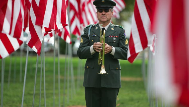 In this undated file photo, Ferron Holt stands at attention with his bugle after blowing Taps as a bell tolls 11 times in memory of local veterans who've passed away in the past year Tuesday during the Veterans Day program at Veteran's Park in Washington City. Snow Canyon Middle School students will honor both active duty and retired members of the U.S. military in a concert that is free and open to the public, and starts at 7 p.m. immediately.