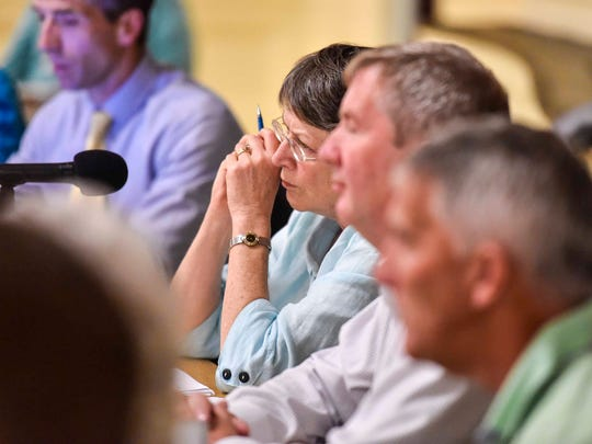 Burlington City Council President Jane Knodell listens as members of the public speak in favor of Keep BT Local, one of three bidders being considered in the sale of BT Telecom, during a public comment portion of a meeting of the council on Monday, September 25, 2017.