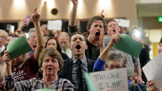 People shout to Rep. Jason Chaffetz during his town hall meeting Feb. 9, 2017, in Cottonwood Heights, Utah.