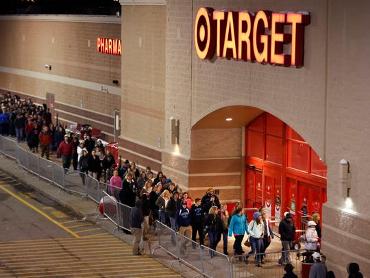Shoppers head into Target just after the doors opened