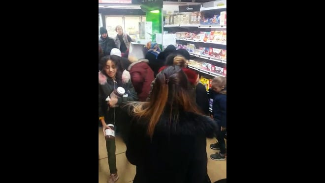 In this image taken from video a customer carries away pots of Nutella, as others congregate around a display of the product in a supermarket in Toulon southern France on Jan. 25, 2018.