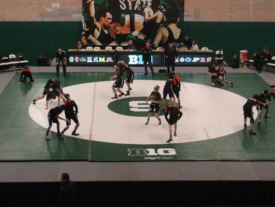 Brighton wrestlers warm up prior to Sunday's dual with