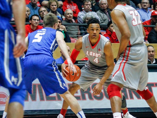 New Mexico's Elijah Brown (4) looks to pass guarded by Air Force's Zach Kocur (5) during the first half an NCAA college basketball game, Wednesday, Jan. 27, 2016, in Albuquerque, N.M. (AP Photo/Juan Labreche)