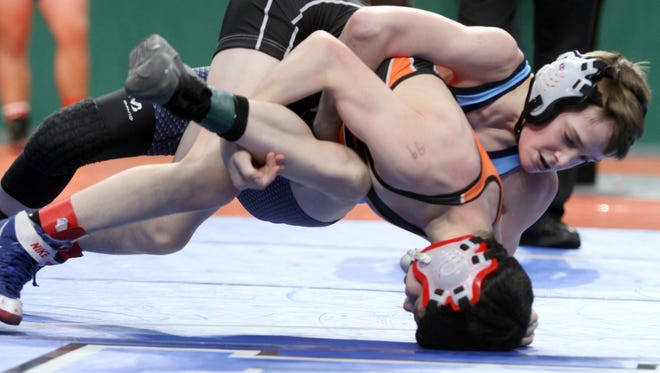 Dennis Robin of Arlington defeated  Aiden Rabideau of Clarence in a 99 pound bout during the quarterfinals of the NYSPHSAA Wrestling Championships at the Times-Union Arena in Albany Feb. 24, 2017.