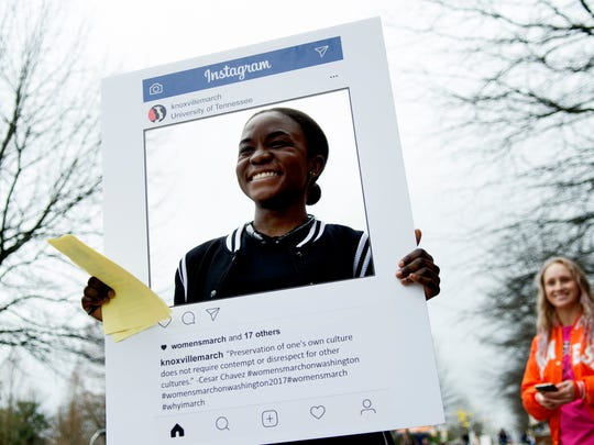 Oyinda Akintola takes a photo with a knoxvillemarch Instagram frame at a Women and Allies rally outside of John Hodges Library at University of Tennessee in Knoxville, Tennessee on Thursday, January 19, 2017. Organizers were making signs and taking photos for social media in preparation for tomorrows Women's March on Washington.