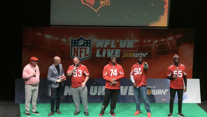 Oct 21, 2017; London, United Kingdom; Arizona Cardinals coach Bruce Arians (left) and players A.Q. Shipley (53}, D.J. Humphries (74), Frostee Rucker (92) and Chandler Jones (55) are interviewed by Neil Reynolds (second from left) during NFL UK Live at The Mermaid London.