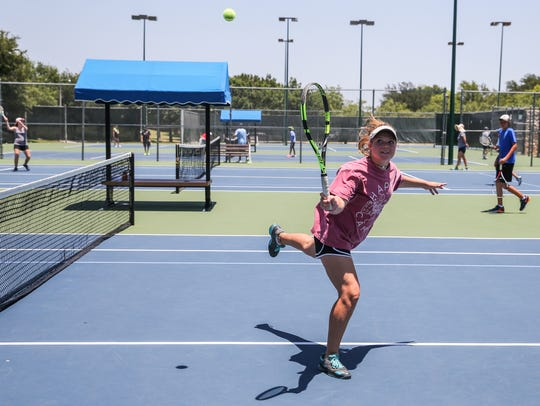 Addison Henson plays tennis during camp Thursday, June