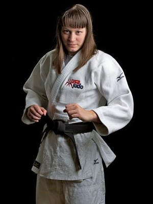 Katie Sell, born and raised in Oshkosh, is hoping to qualify for the 2016 Olympics in Rio de Janeiro.