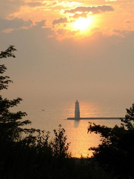 A sunset view of the Frankfort pier from the Elberta Bluffs.