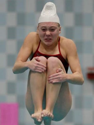 Neenah's Av Osero completes a dive during the WIAA Division 1 state meet Saturday at the UW-Natatorium in Madison.