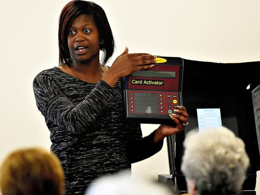 York County Elections and Voter Registration Director Nikki Suchanic talks to poll workers about the card activator device during a training session at the Red Lion Area Senior Center in Red Lion, Pa. on Tuesday, Oct. 20, 2015. Dawn J. Sagert - dsagert@yorkdispatch.com
