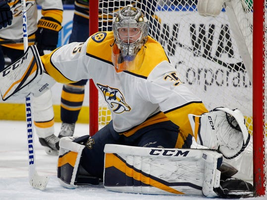 Nashville Predators goalie Pekka Rinne (35) watches the puck during the third period of an NHL hockey game against the Buffalo Sabres, Monday, March 19, 2018, in Buffalo, N.Y. (AP Photo/Jeffrey T. Barnes)