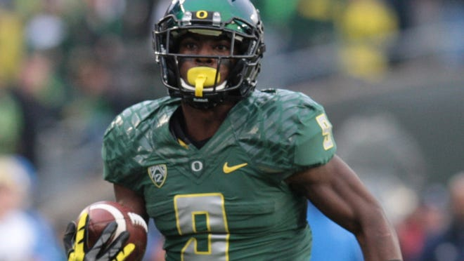 Oregon's Byron Marshall (9) runs for a touchdown in the second quarter against  UCLA on Saturday at Autzen Stadium.