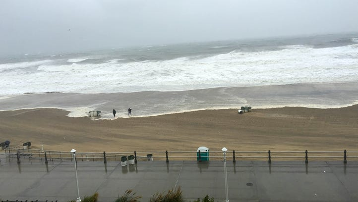 Curious onlookers brave the conditions Sept. 3, 2016, to step onto the beach as Tropical Storm Hermine moves by.