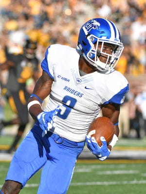 MTSU wide receiver Richie James (3) with the catch and run in MTSU's win at Missouri.