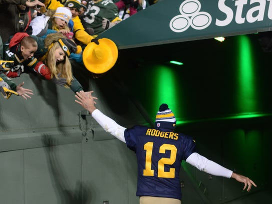 Green Bay Packers quarterback Aaron Rodgers (12) high