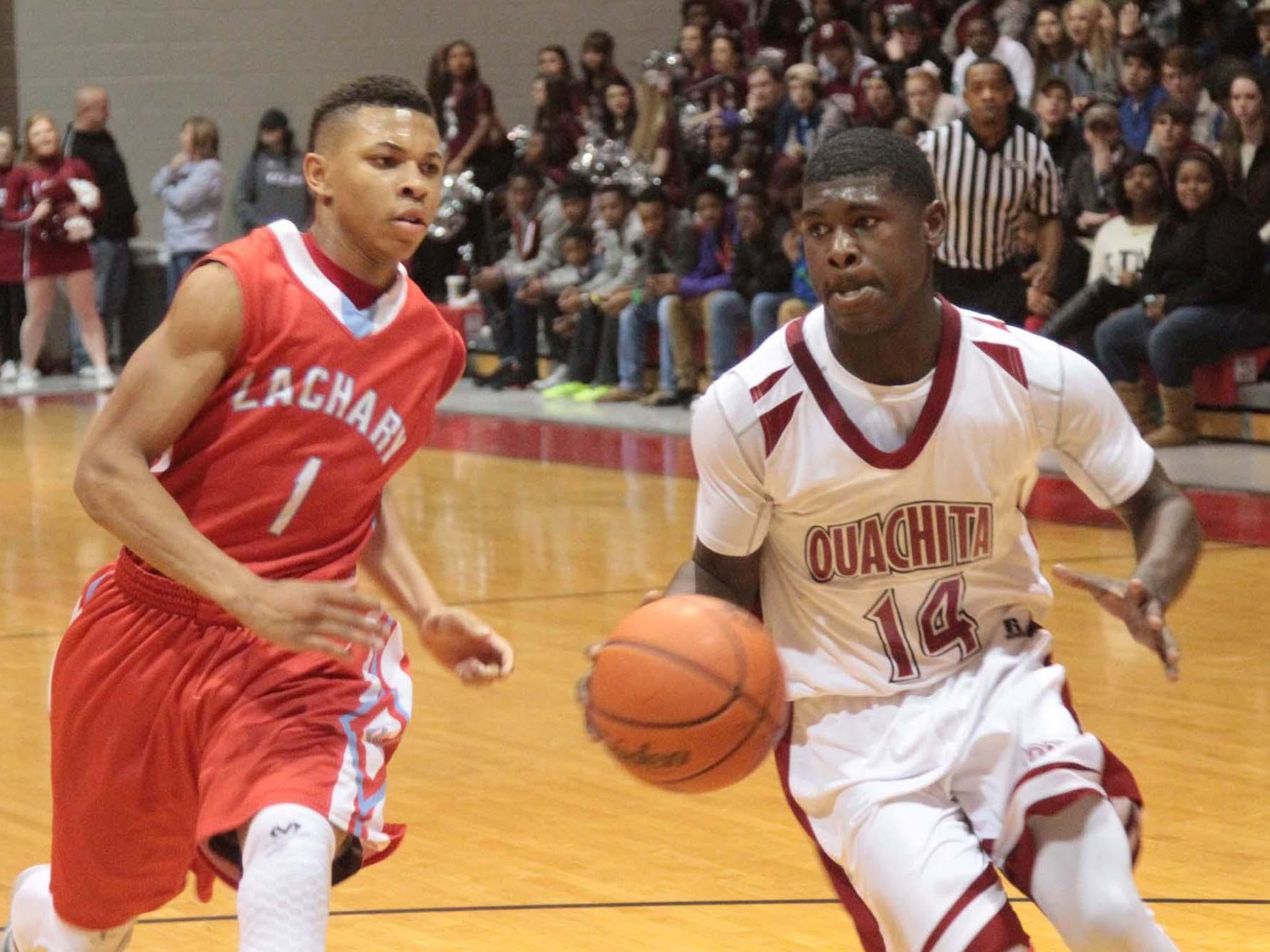 MARGARET CROFT/THE NEWS-STAR Ouachita guard Cephus Gix (left) scored 20 points on Tuesday at Ruston. Ouachita hosts Zachary in first-round action of the LHSAA Class 5A Boys Basketball championships on Friday.