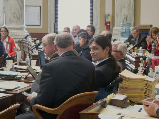 Rep. Adam Rosendale, center, a Republican from Billings, attends a House session March 14 at the Capitol in Helena.