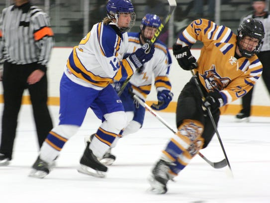 Eluding a Lake Superior State player's check during