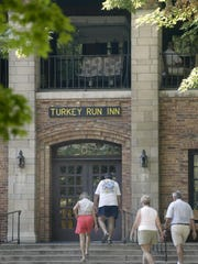 People enter the front of the Turkey Run Inn at Turkey