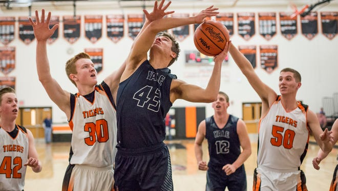 Yale sophomore Sean Koepf takes a shot over Armada junior Jared Couch during a basketball game Friday, Feb. 26, 2016 at Armada High School.