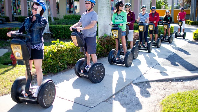 A group on people enjoy a tour from Segway of Naples in downtown Naples Samuel Wilson/Staff