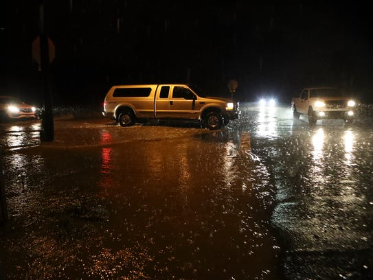 Motorists drive through high water at Old Alturas Road