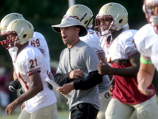 Riverdale's head coach Will Kriesky pumps up his players