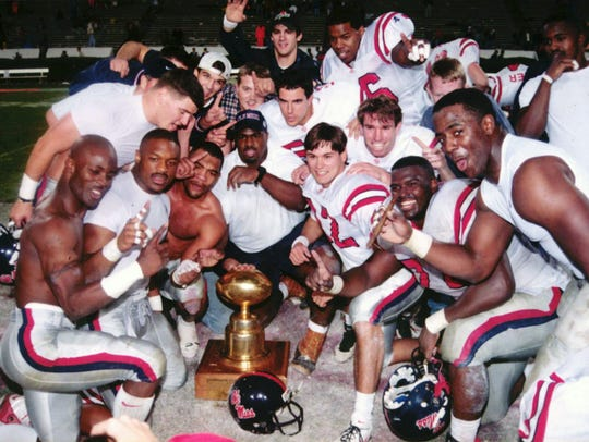 Ole Miss players celebrate after a 15-14 win in the