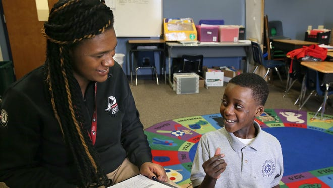 Dominique Cherry, an elementary literacy tutor with Wisconsin Reading Corps, works with Malachi Sykes, 9, a third-grader at Milwaukee Academy of Science.
