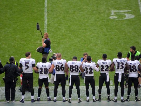 Baltimore Ravens quarterback Joe Flacco (5) and coach