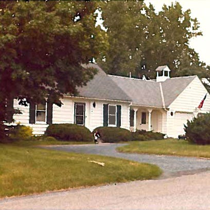 An old photograph of the family home in Minnesota that will make way for a new family's home.