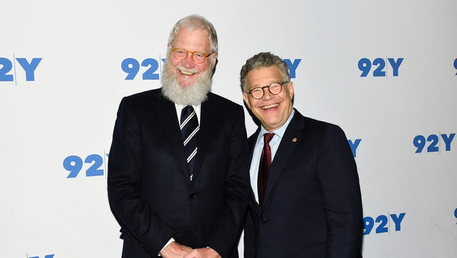Sen. Al Franken, D-Minn., right, and former talk show host David Letterman are shown at a New York event in May.