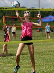 Natalie Johanknecht spikes the ball against her opponent