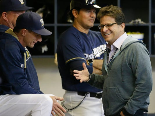 Milwaukee Brewers owner Mark Attanasio, right, shares a laugh with manager Craig Counsell before their game against the Pittsburgh Pirates Wednesday, Sept. 21, 2016, in Milwaukee. (AP Photo/Jeffrey Phelps)
