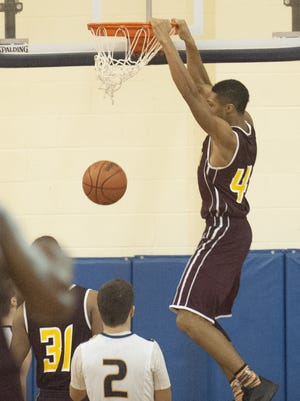 Glassboro's David Still finishes with a two-handed dunk during the 4th quarter of the game at Gloucester.