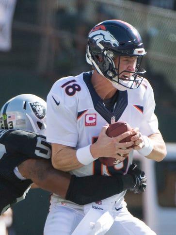 Denver Broncos quarterback Peyton Manning (18) is sacked