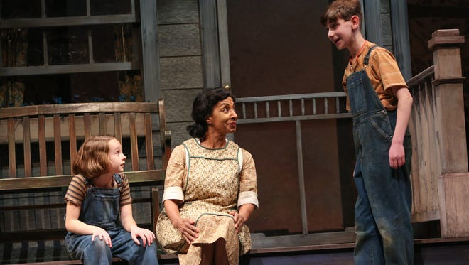 Erin Mueller as Scout Finch, Nora Cole as Calpurnia, and Harry Franklin as Jem Finch in To Kill a Mockingbird at Geva.