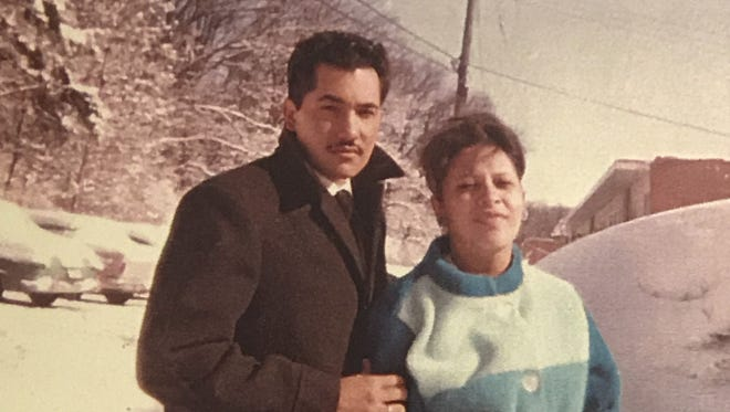 Luciano and Martha Barraza pose in front of their snow-covered car outside their first apartment at Eagle Heights at UW–Madison in 1963. Luciano, a native of Mexico, had just begun his graduate work in agricultural economics. He completed work on a doctoral degree in 1967 but was unable to participate in the commencement ceremony. Fifty years later, he will get that chance on Sunday.