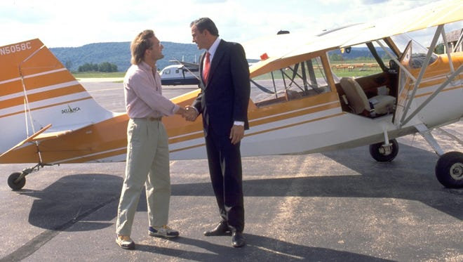 """Matthew Bruch (left) and George Woodard in a scene from """"Time Chasers"""" shot at the Southern Vermont Regional Airport."""