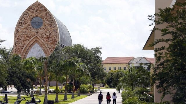 Patrons are seen on campus near the iconic Quasi Parish Ave Maria Oratory Tuesday, May 12, 2015, at Ave Maria University.