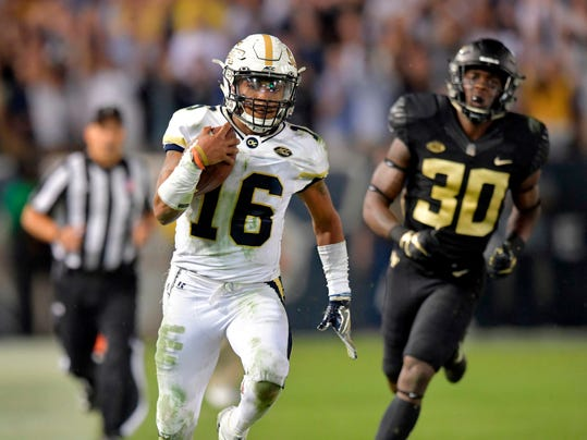 FILE - In this Oct. 21, 2017, file photo, Georgia Tech quarterback TaQuon Marshall (16) runs for a touchdown during the second half of an NCAA college football game against Wake Forest in Atlanta. Marshall's 2017 season included some of the best running _ and worst passing _ for a player at his position in school history. (Hyosub Shin/Atlanta Journal-Constitution via AP, File)