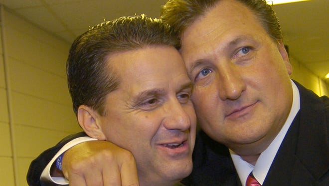 Bob Huggins (right) hugs John Calipari at U.S. Bank Arena, the site of a 2005 roast/salute to the former University of Cincinnati coach.