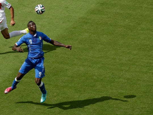 Italy's Mario Balotelli controls the ball during the group D World Cup soccer match between Italy and Costa Rica at the Arena Pernambuco in Recife, Brazil, Friday, June 20, 2014.  (AP Photo/Hassan Ammar)