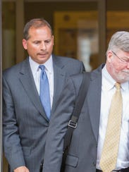 Joseph Terranova (left), who headed Wilmington Trust's Delaware commercial real estate division, leaves federal court in Wilmington in 2013 with his lawyer, Patrick Cotter.