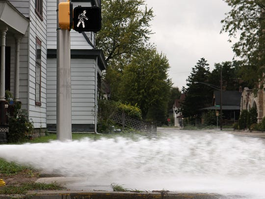 Indiana American Water Co. flushes a fire hydrant in
