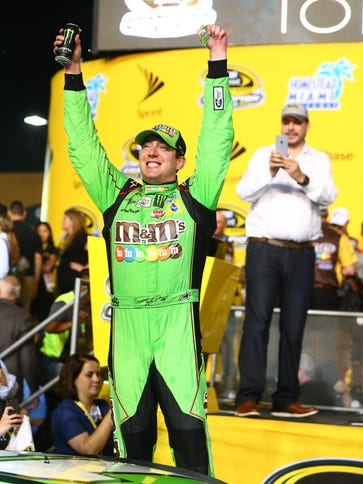 Kyle Busch celebrates in after winning the Ford EcoBoost