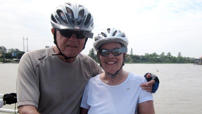 Reader photo - Chuck and Marilyn Mathias at the Mekong River during their bike trip from Ho Chi Minh City/Saigon Vietnam to Siem Reap/Angkor Wat Cambodia.